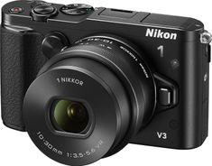 Nikon digitalni fotoaparat 1 V3 + 10-30MM + iskalo + držalo