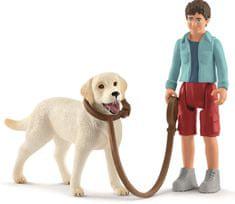 Schleich sprehod z labradorskim prinašalcem