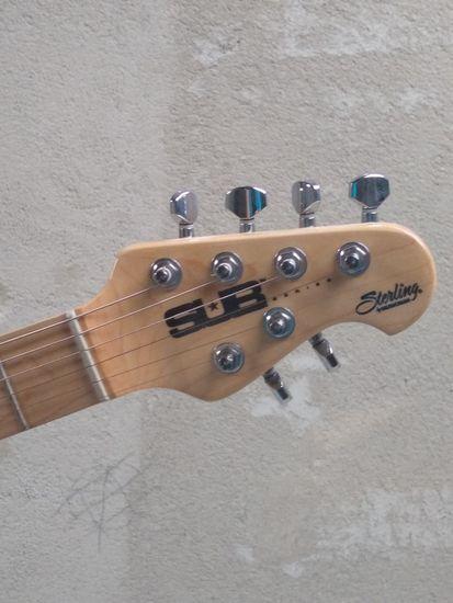 Sterling by MusicMan SUB AX3 Transparent Black elektrická kytara, černá