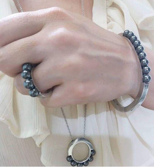 Calvin Klein Jekleni obroč s krožnimi kroglicami KJAKMR0401